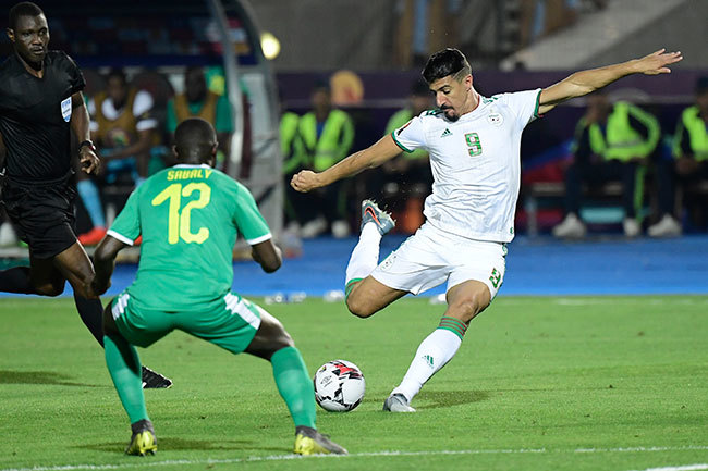 lgerias forward aghdad ounedjah shoots to score during the 2019 frica up of ations  inal