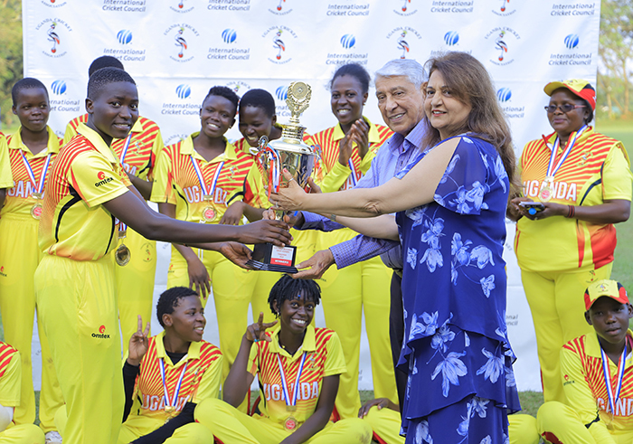 ponsor ziz amani  and his wife hands over the trophy to  ganda 19 cricket girls team for winning the ganda anzania ilateral cricket tournament held at yambogo val ground on riday