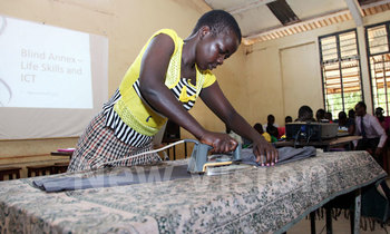 Lucy agenorwod ironing a trousor at the event photo by hajara nalwadda 350x210
