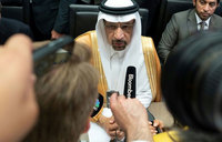 Oil prices tumble even as producers extend supply agreement