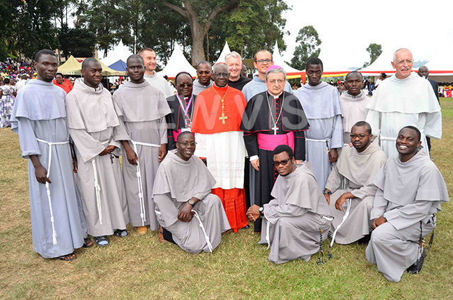 ardinal arah wearing red biretta rchbishop ianco and rchbishop wanga with some of the ranciscan riars that graced the musical event