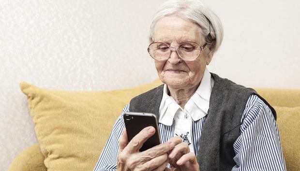 grandmotherwithphone100633728orig