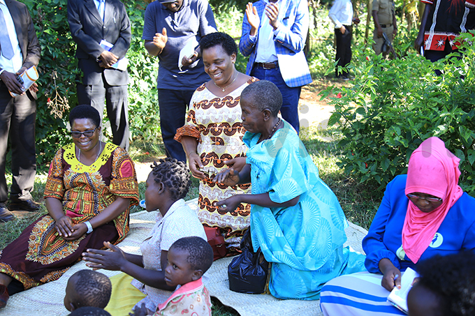 ne of the beneficiaries aria egina in blue hosted the team at her home in wanda village iboga district hoto by loria akajubi