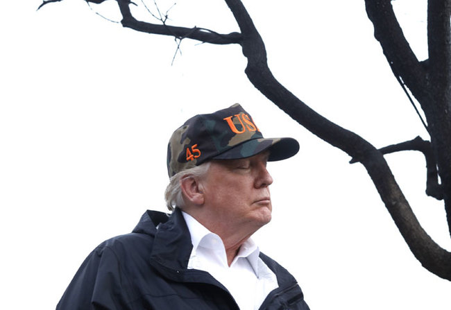 resident onald rump spends a moment with his thoughts while touring damage from the oolsey fire in alibu on ovember 17 2018 hoto