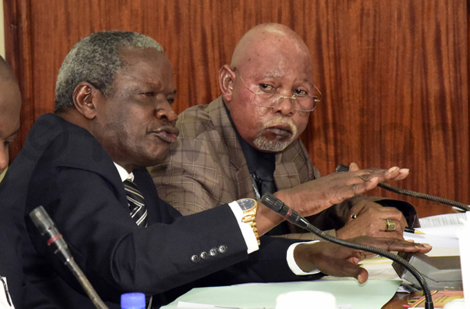 tate inister for nternal ffairs biga ania  presents budget requirements before the efence and nternal ffairs ommittee of arliament while inister of nternal ffairs eje dongo looks on hoto by ennedy ryema