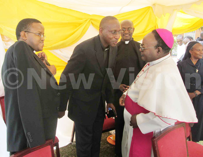 rchbishop wanga with skull cap having a light moment with atholic priests after the hrism mass