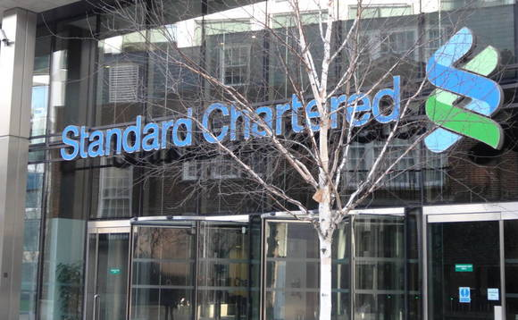 Standard Chartered sets aside $900m to cover US, British fines