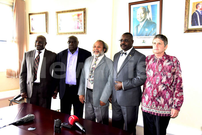 he eputy peaker of arliament acob ulanyah second right posing for a picture with inister of oreign ffairs ederal epublic of est apua acob umbiak centre while lory to lory inistries  enior astor ahimbisombwe second left  imon ulongo left and  ed ryne right look on during a visit to arliament