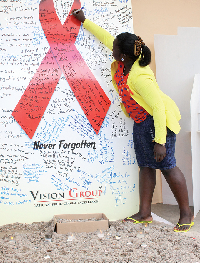 ision roup staff writes a message in memory of her loved one and in support of those living with s last year enis ibira of ganda says testing is the first step to eliminating the epidemic