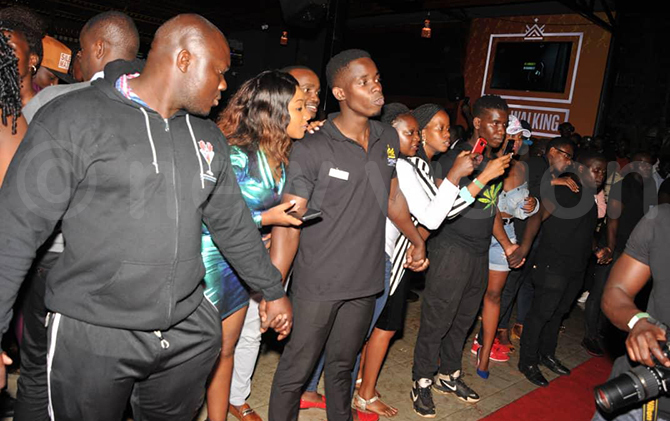 ecurity keeps fans at bay during the meet and greet event hoto by arim sozi