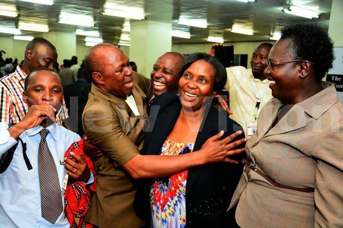ncumbent harles akabulindi congratulates argaret amubiru wabushaija after the orkers  elections hoto by iriam amutebi