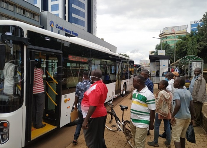eople gather to look at ayoola bus when it made a stop at the ity square during a oadshow on riday hoto by uth asejje