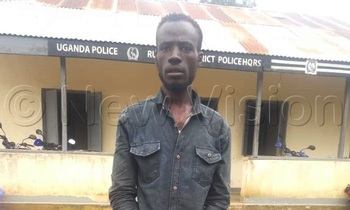 Apollo basajja on handcuffs after he was arrested 350x210