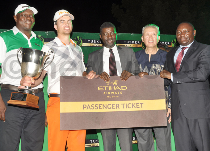 eale will also travel in business class to bu habi after tihad irways general manager oyin laran  presented him the ticket hoto by ichael subuga