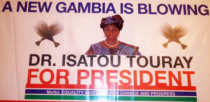 hoto shows ambias firstever female presidential candidate for countrys ecember presidential election ssatou ouray campaign banner on eptember 2 2016 in anjul