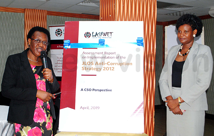 ulyagonja and the  executive director ylvia ukasa launching the assessment report at otel fricana hoto by ary ansiime