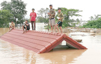 19 bodies found after Laos dam collapse, hundreds still missing
