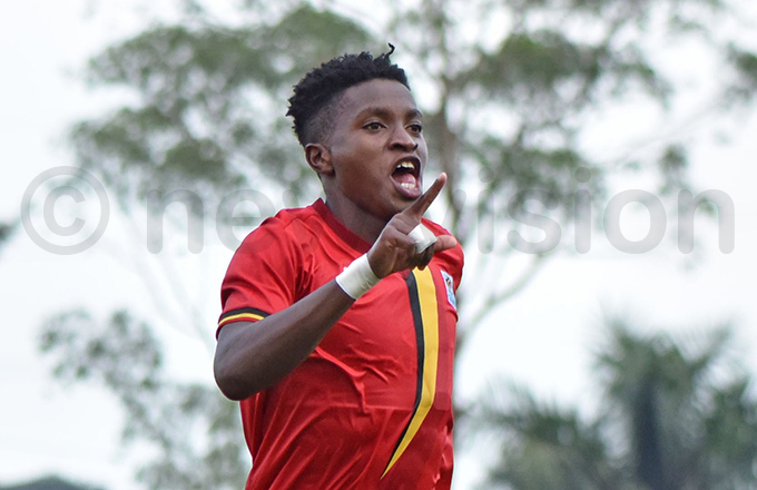 lan kello celebrates his strike as ganda secured qualification for  2020 hoto by ichard anya