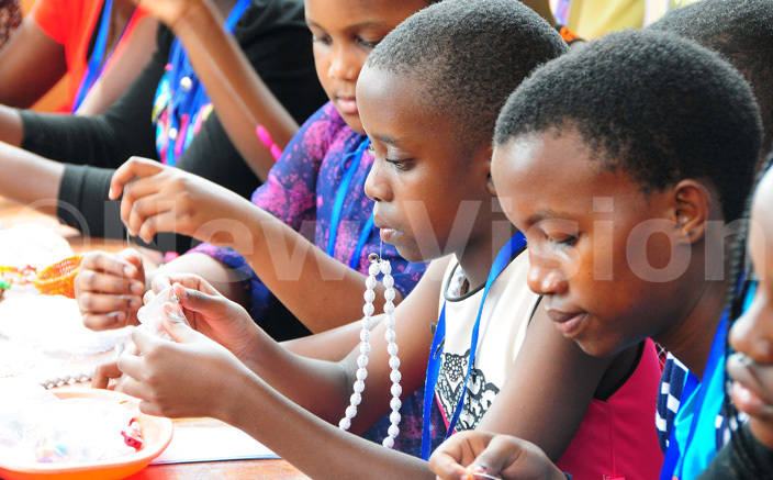 ome of the children learn how to make jewelry using beads