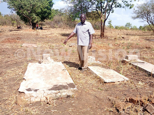 td apt ajul son to the late rig koya pointing at the grave where his father was buried after he was killed under the orders of min in 1970 hoto by rnest umwesige