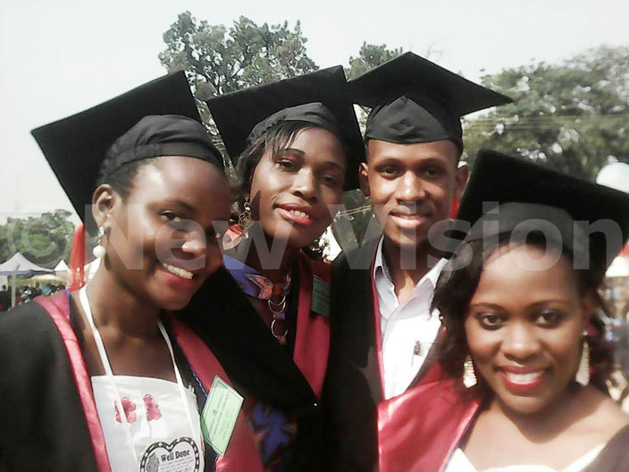 oreen yaburu 2nd left poses for a photo with colleagues during their graduation at yambogo university