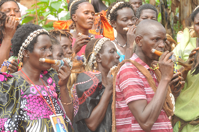 baswezi blowing their flutes during the ceremony on unday hoto by onald iirya