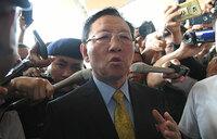 Expelled N. Korea envoy fires final salvo from airport