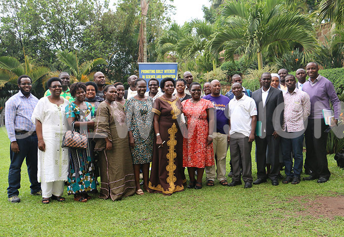 econdary school teachers and head teachers pose for a photo with  staff after the workshop hoto by ilson anishimwe