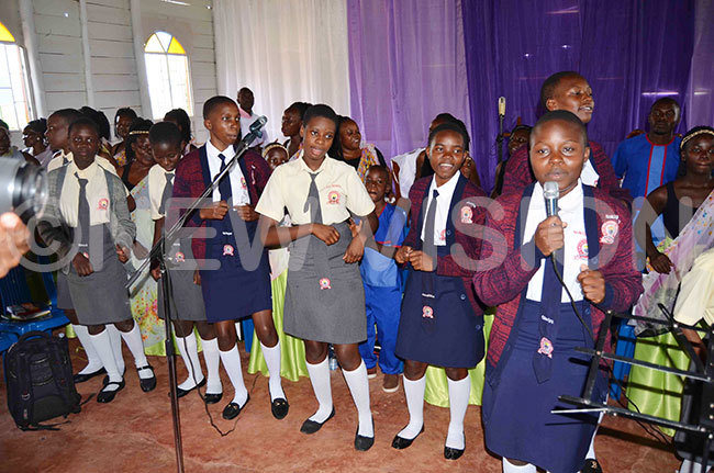 he students from lite igh chool ntebbe leading the praise and worship session during the service