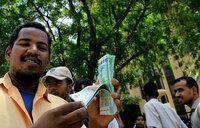 Sudan sharply devalues currency as economic crisis bites