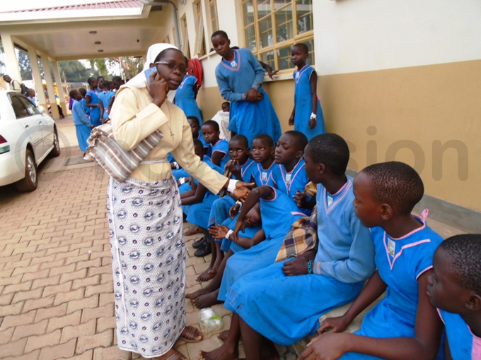 ome of the injured pupils being comforted by a teacher hoto by oses ikala