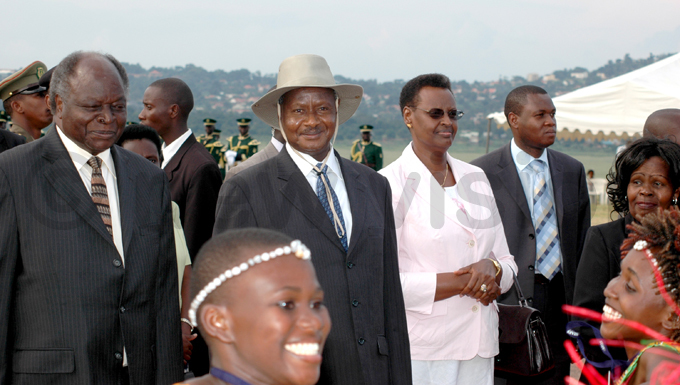 ucy ibaki  pictured with residents useveni and ibaki as well as irst ady anet useveni upon arrival at ntebbe nternational irport for a state visit in 2007