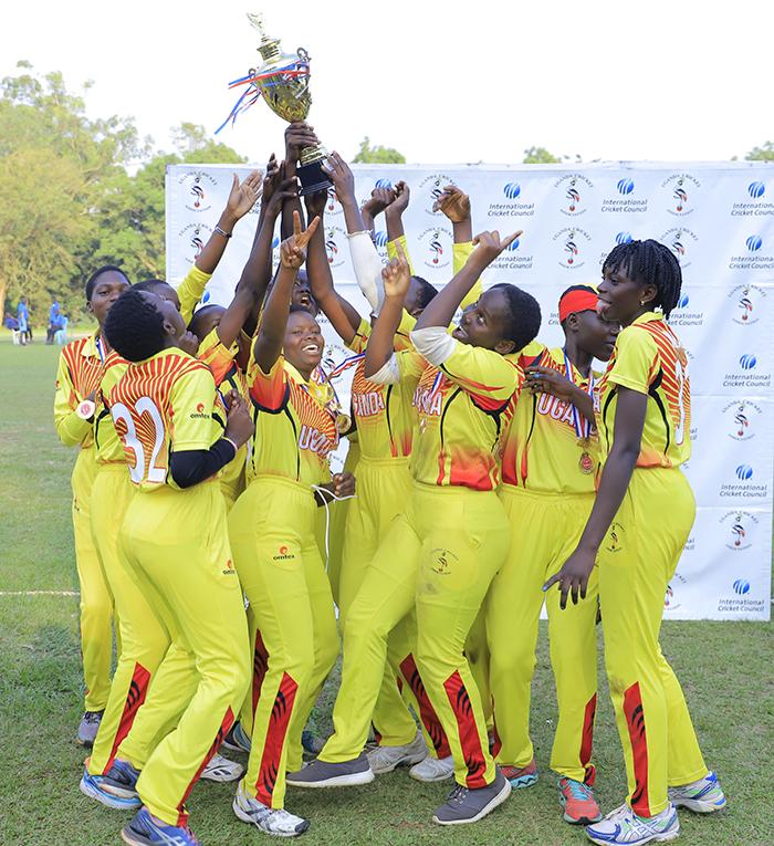 ganda 19 girls cricket team elebrate winning the anzania ganda ilateral ricket tournament held at yambogo val on riday