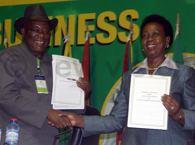rof enry wisa the  board chairperson with umusiime after the signing hoto by olomon alema