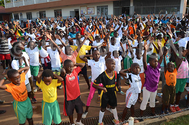 he children doing physical exercises in preparation for the charity run