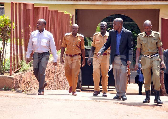 ob asangoleft and ilton utegeya second right arrive at the nti orruption hey  conspired to forge a judicial document in order to steal pension cash amounting to sh154b hoto by enis ibele