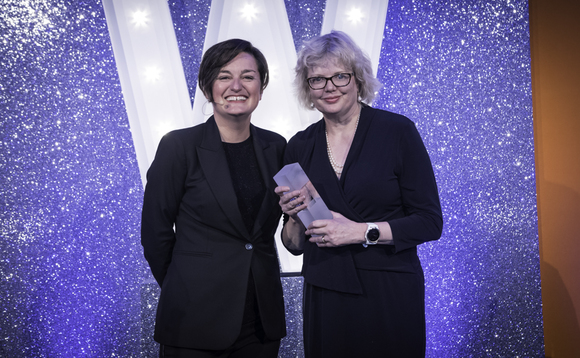 Baillie Gifford's Sarah Whitley picks up the Lifetime Achievement Award from host Zoe Lyons