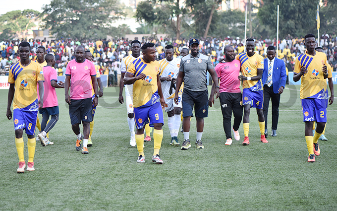 players and backroom staff walk off after the match hoto by ichard anya