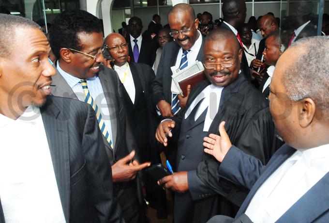 resident usevenis lawyer iwanuka iryowa  and the information minister im uhwezi chat with the eputy ttorney eneral wesigwa ukutana after the ruling hoto by icholas neal