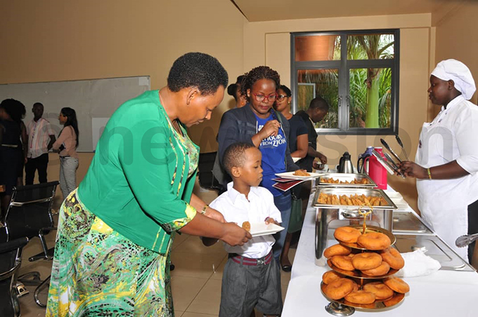 resh id is served a snack on his first day at ampala arents chool hoto by arim sozi