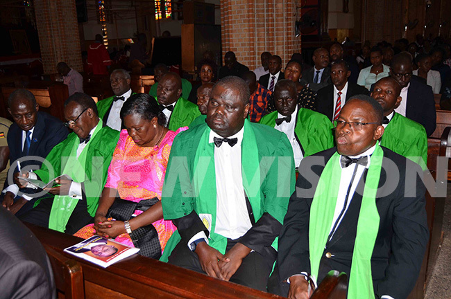 he ompany ecretary of ision roup and national head of the atholic laity ervase dyanabo left with the nights of t atia ulumba during the requiem mass