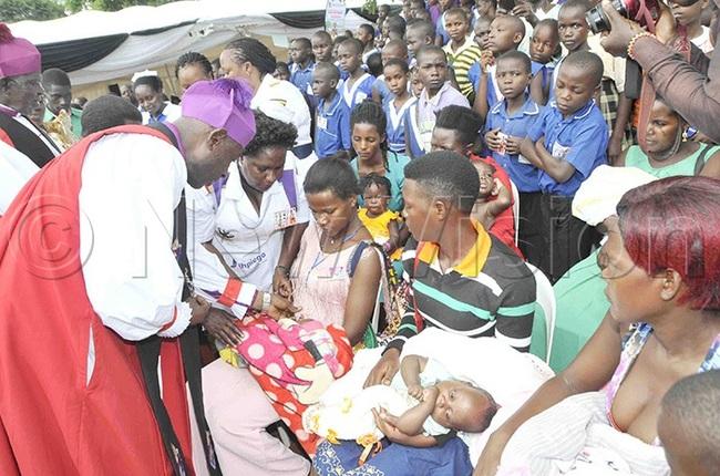 rchbishop aziimba immunizing a child