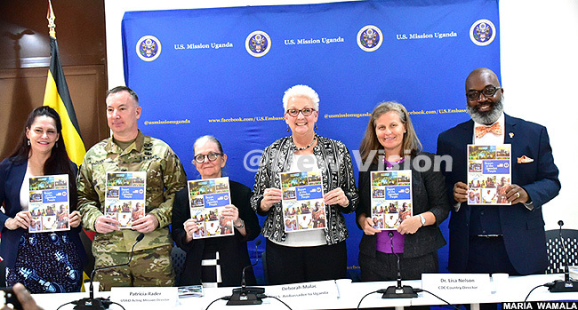 mbassador eborah alac 3rd right flanked by deputy director of entrr for iseases ontrol isa elson 2nd right eace orps country director ames am far right  acting mission director atricia ader 3rd left  defense attache ol  upont 2nd left and  coordinator my unningham