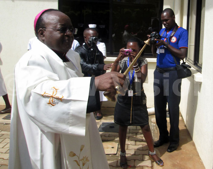 rchbishop wanga sprinkles holy water on the walls of the newly inaugurated octor oser aternity ard on riday