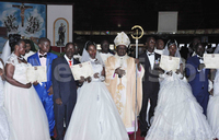Six couples tie the knot at  mass wedding