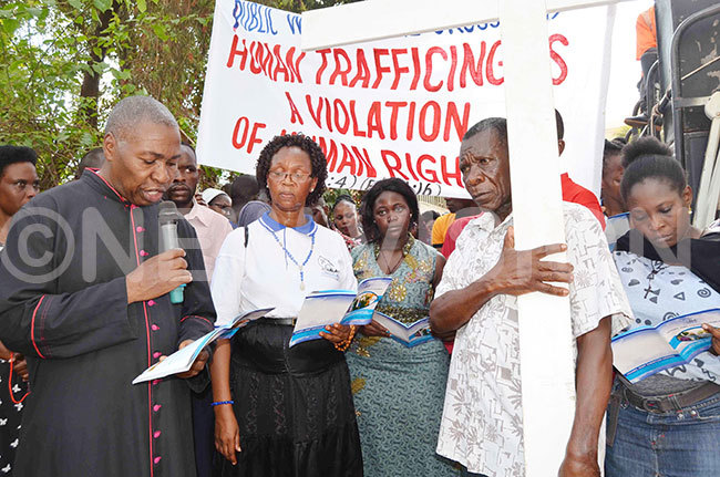 sgr alumba reads a scripture during the ecumenical public way of the ross