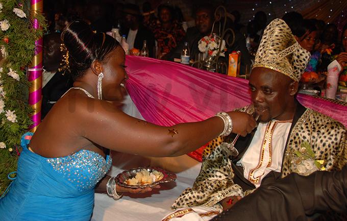 rene amatovu feeding eoffrey utaaya during their introduction ceremony in pril 2010