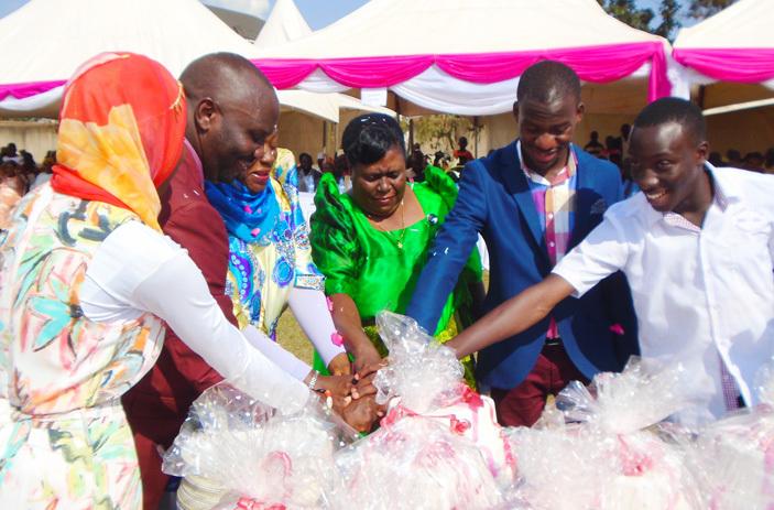 sebaggala cuts cake with family members