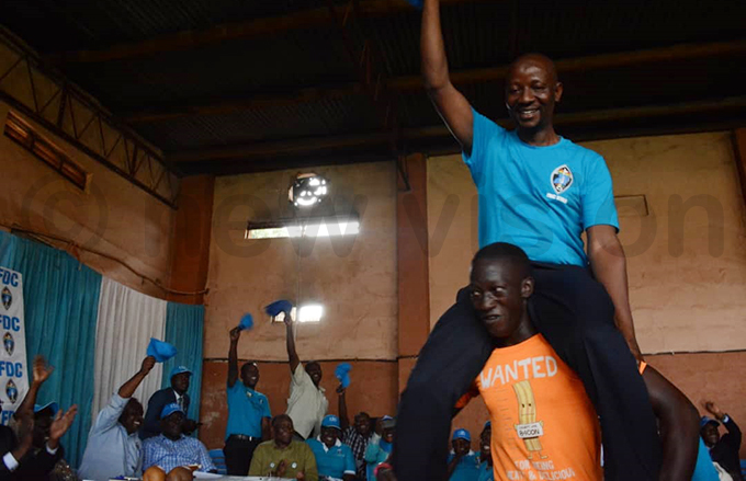 spokesperson brahim semujju ganda is held aloft by a dancer during the celebrations hoto by imothy urungi