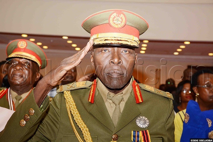 Kasirye Gwanga saluting at a function where he was promoted to the rank of Major General. (File photo)